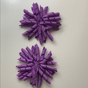 Two purple hair accessories
